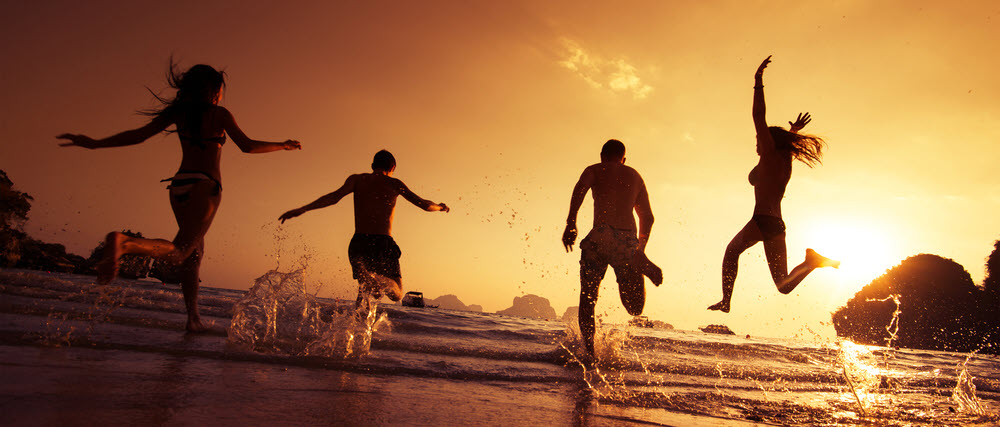 Splashing in the waves with friends