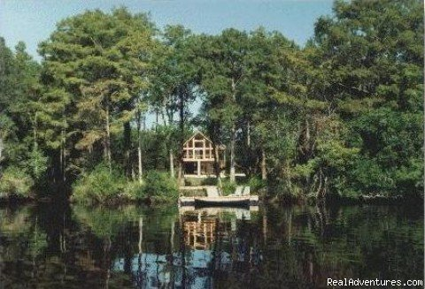 Elevated vacation home with cathedral ceilings and glass front overlooking the beautiful Satilla River.  Floating dock and canoes give access to miles of exploring along this historic site of 18th century rice plantation and 19th century sawmill.