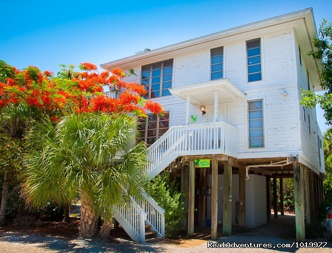 Two story stilt home of 2,200 sf, with community beach access, pool and tennis courts.  Lush landscaping in a quiet setting.  Fully furnished including all kitchen appliances and utensils, all linens and towels, beach chairs and toys for the kids.