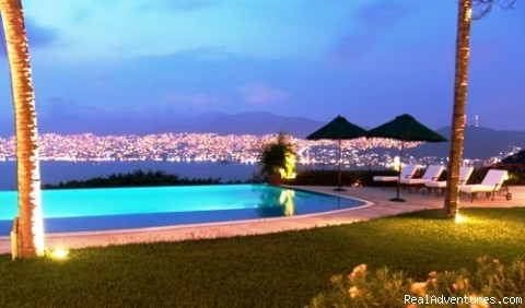 Enjoy the night lights of Acapulco Bay.  - Acapulco Luxury Villa Rentals