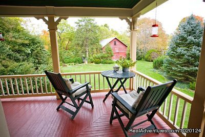Relaxing on the wraparound porch - Country hospitality at the Hummingbird Inn