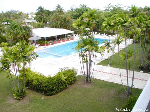 A view of the pool, garden from #316 - West coast Barbados condo with swimming pool