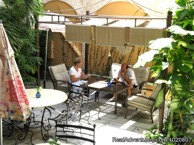Guests relaxing at courtyard - CANCUN  INN, Suites   El Patio, Puerto Cancun