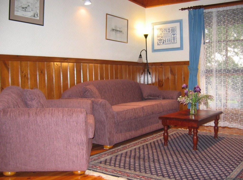 The comfortable apartment lounge | Image #2/6 | Romantic Buttercup Cottage & Private Apartment