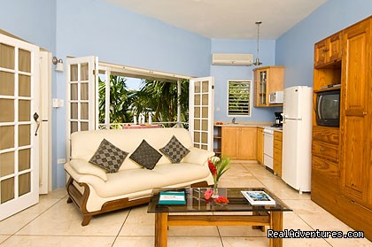 One bedroom beachfront villa living room - Rondel Village: A romantic beachfront retreat