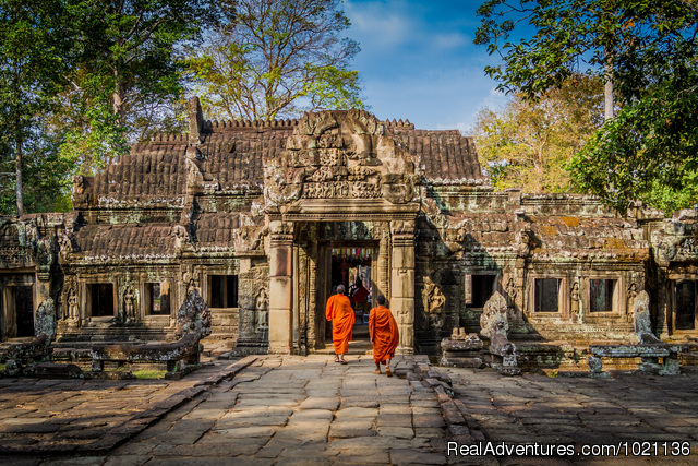 Buddhist monks enter one of the many Angkor temples,Cambodia - Asian Trails