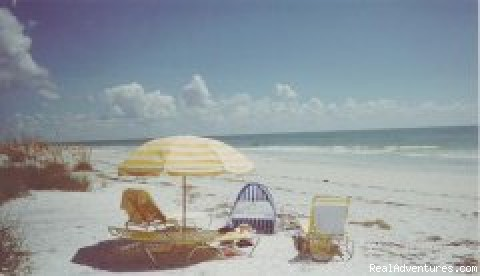 Swim or sun on the beautiful beach. -  Gulffront Luxury Vacation Condo on Sanibel Island