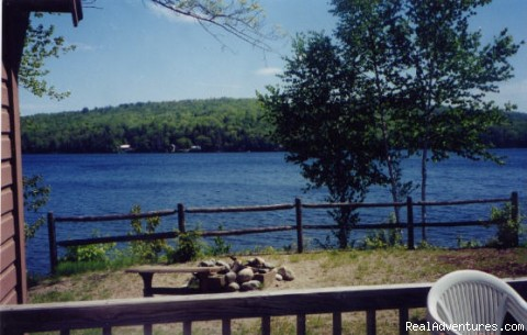 Relaxing look from a deck to the lake - Embden Lake Cottages