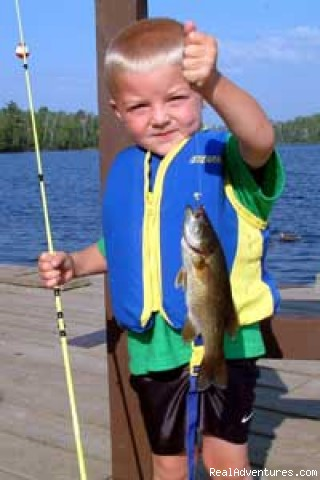 Grandson with bass - Gunflint Lodge-family vacations in northeast MN