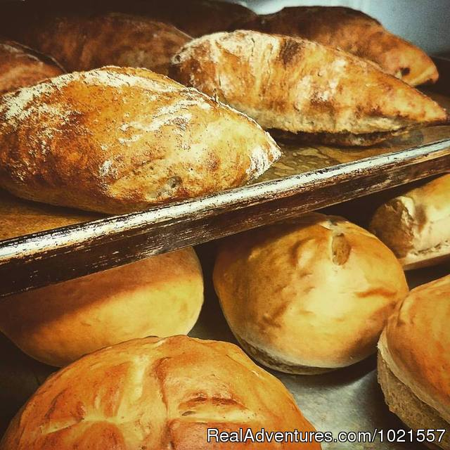 Serving housemade bread always with dinner - Camano Island Waterfront Inn