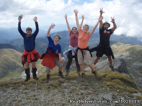 Celebrating reaching the summit of Mt Arthur - Hiking New Zealand