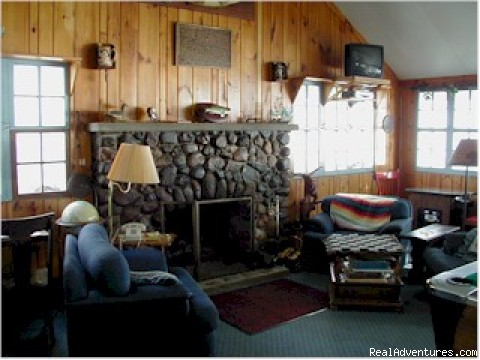 Relax by the historic fireplace in our L - The Lodge on Otter Tail Lake
