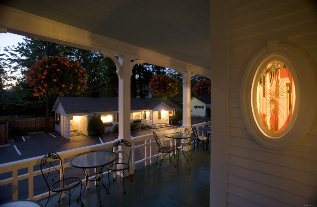 Wraparound porch at dusk viewing our guest houses | Image #15/18 | Maine Stay Inn - Premier Kennebunkport B&B