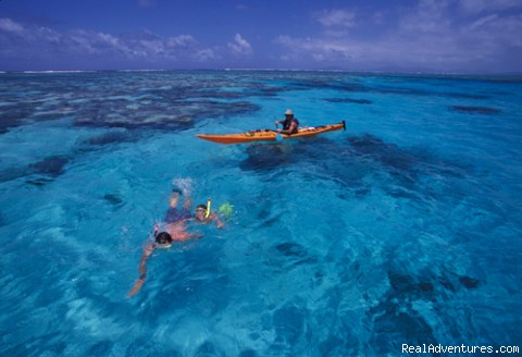 Kayaker and snorkellers - Sea-kayak Fiji