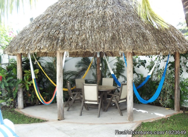The downstairs dining area - Cozumel 4 bd with 2 level pool, garden, hammocks