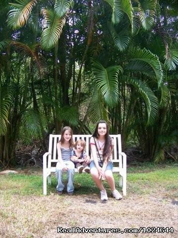 Garden visitors on bench - Hana Maui Botanical Gardens B&B/Vacation Rentals