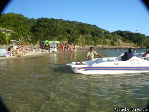 Azeda beach with view of a water taxi - Buzios Internacional Apart Hotel