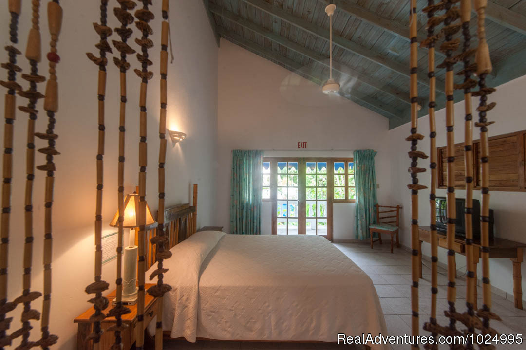 Upper Reef House Queen Bedroom | Image #9/16 | Caribbean Castles at Beach House Villas