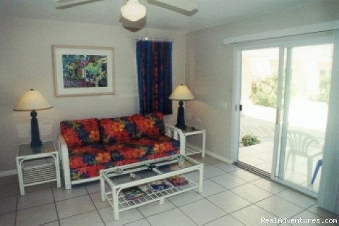 Living room with glass doors to patio (#8 of 22) - Caribe Sands Beach Resort - Dive Cayman Brac
