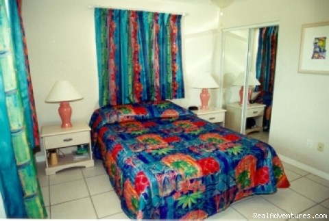 Queen-size bed in the large bedroom (#9 of 22) - Caribe Sands Beach Resort - Dive Cayman Brac