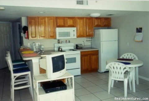 Full-size appliances in the fully-equippen kitchen (#10 of 22) - Caribe Sands Beach Resort - Dive Cayman Brac