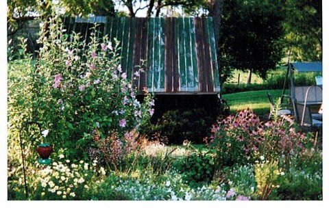 Flowers around the wood shed - Garden Gate Get-A-Way Bed & Breakfast