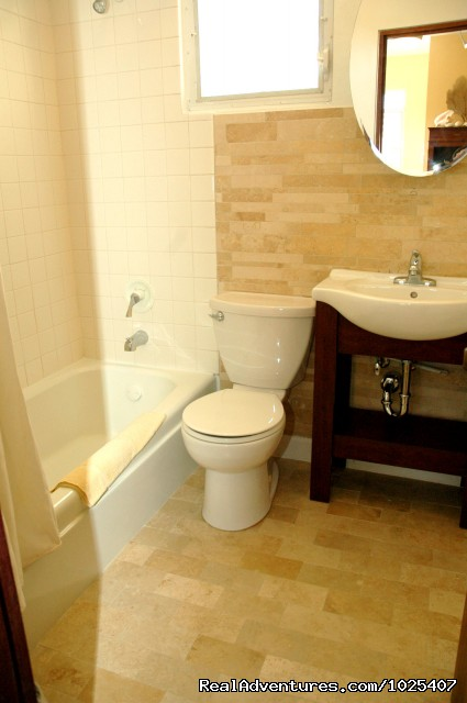 New Travertine Bath, tub, 'Shell' Suite at Colibris - El Prado Villas, Ocean Park, San Juan's best beach