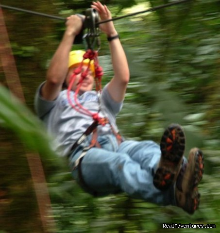 Zip lining through the rain forest at Arenal Volcano - Bill Beard's Costa Rica 2017-18 Vacation Packages