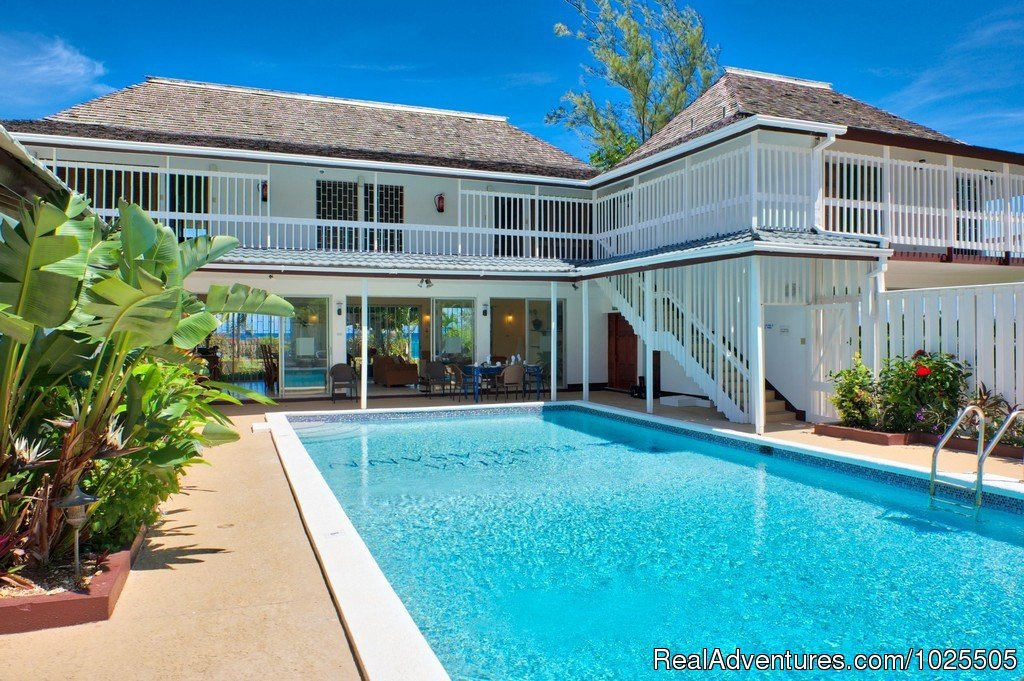 Modern beachfront vacation luxury on a budget. Great large pool with a panorama ocean view . The villa is fully staffed with a cook/maid, groundskeeper and offers 1st.meal on arrival with a min. of 5 night