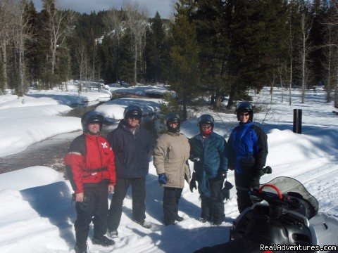A pause along Dunham Creek - Rich Ranch Winter Snowmobiling Adventures