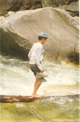 Student crossing the River at Kasol - School Tours in India