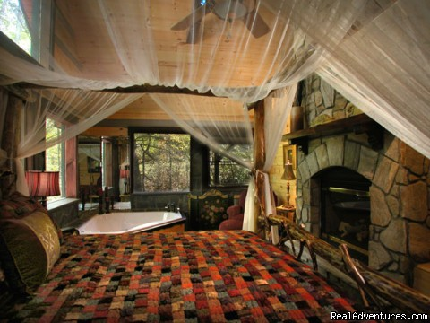 Creekside luxury log cabins in the Smokies Romantic bedroom with fireplace and Jacuzzi (Slippery Rock)