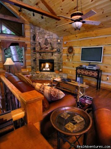 Creekside luxury log cabins in the Smokies Upscale amenities include flat screen TVs (Cherokee Lodge)