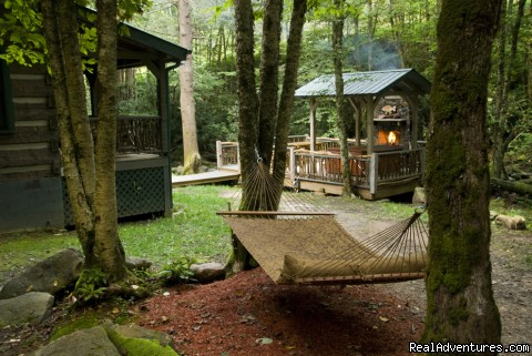 Creekside deck with fireplace and hot tub (Waters Edge) - Creekside luxury log cabins in the Smokies