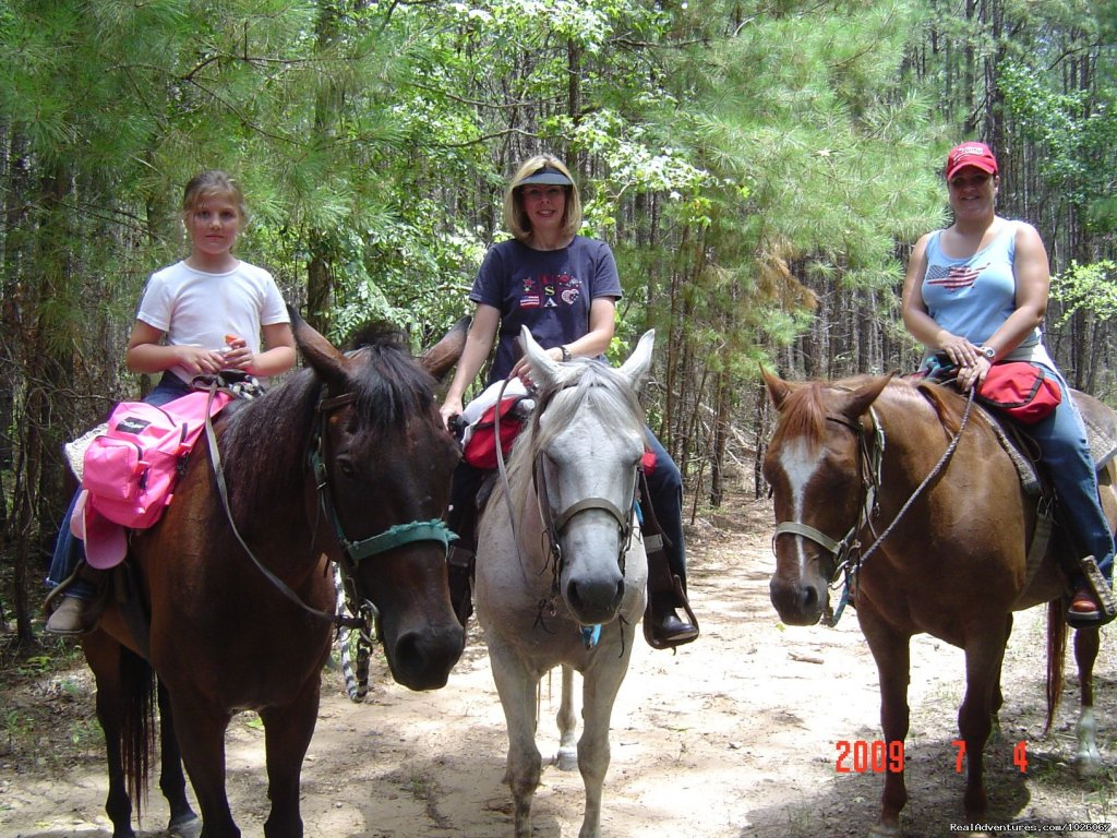 Come ride our beautiful horses on a 3, 4, or 5 hour guided ride in 47,000 acres of Forest land.  Picnic beside a lake.  We also provide riding lessons, boarding and all other horse related services.  Capricorn Equine Services