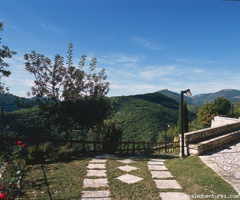 View of the entrance to the garden - Residence Vallemela: a charming mountain retreat!