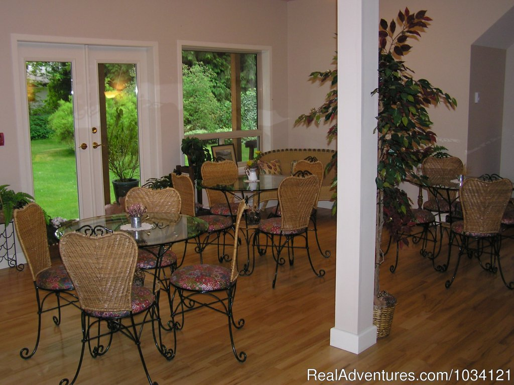 Enjoy our bistro garden-view dining room. | Image #9/26 | Cedar Wood Lodge Bed & Breakfast Inn