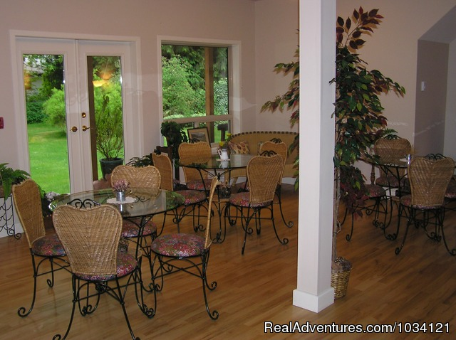 Enjoy our bistro garden-view dining room. - Cedar Wood Lodge Bed & Breakfast Inn