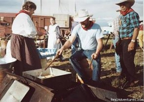 Meal being prepared over firepit (#7 of 14) - Family Adventure on Genuine Covered Wagon Train