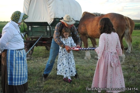 A Staff member teaches how to fold the Flag - Family Adventure on Genuine Covered Wagon Train