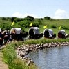 Covered Wagons travel around small lake