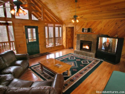 Enjoy the big screen TV and fireplace - Romantic Log Cabin In Woods Near Nantahala Lake