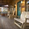 Romantic Log Cabin In Woods Near Nantahala Lake Wide front porch with rockers & hot tub