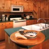 Romantic Log Cabin In Woods Near Nantahala Lake Well-equipped kitchen with dining area