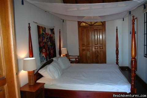 One of two similar bedrooms - Englishman's bay,Parrot estate. Romantic adventure