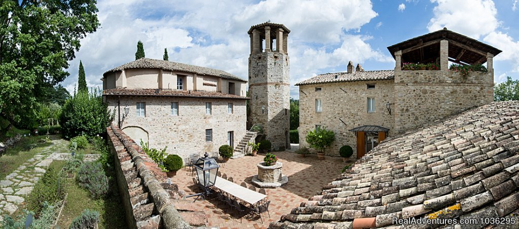 Magnificent 11th century historic Castle/abbey encircling a courtyard, beautifully renovated to create a private house, with 7 luxury rooms and 9 bathrooms. It in the centre of a superb 1500 acres estate, in the centre of Umbria.
