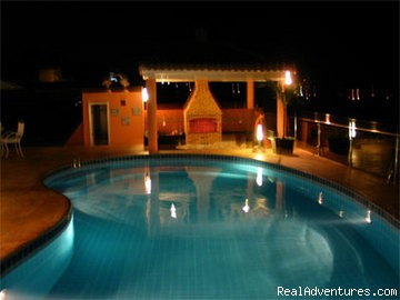 swimming pool by night - Brazilian Dream Beach house