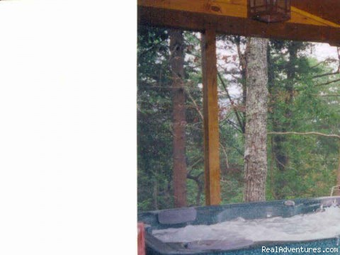 Relax in the out door hot tub - Beautiful vacation log cabins in Blue Ridge, Ga.