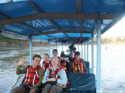 Explore Manu Rainforest and go Trekking in Peru travelling by boat in Manu