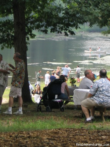 Family relaxing in picnic area overlooking lake - Nature, Comfort & Simplicity, Virginia Cottages